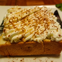 Really thick white bread with whipped cream and cinnamon.